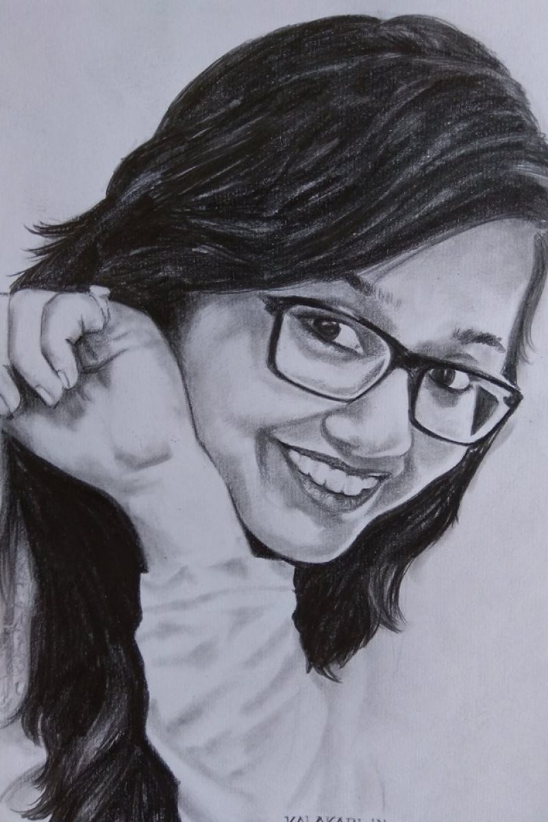 charcoal sketch of a beautiful girl with spects